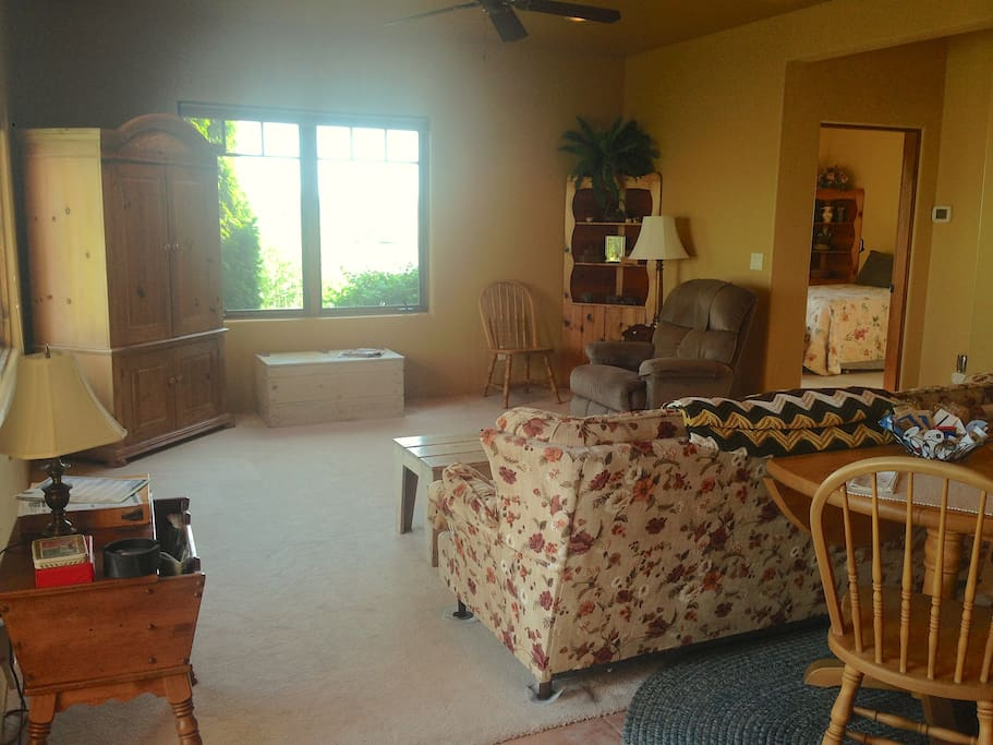 Large living room with ceiling fan and DISH TV