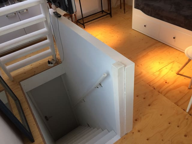 Private stairs to the studio