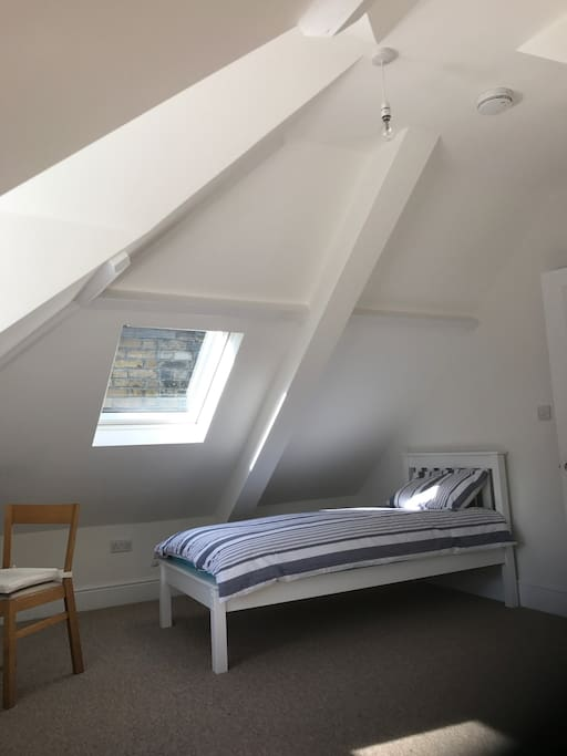 The whole feel of this room is cosy, airy and bright. It has a comfortable single bed, and the room is large enough to accommodate a mattress on the floor for a second guest. Please enquire as this is not advertised as such.