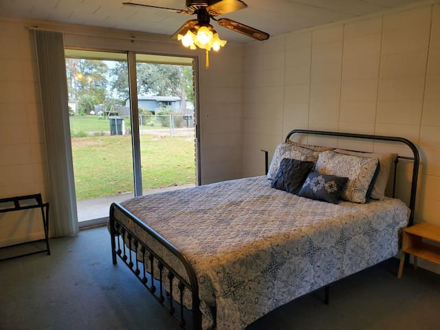 Queen bedroom with USB port and wireless charger