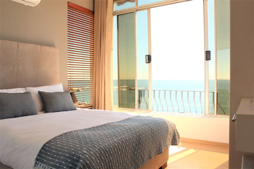 The master bedroom with double doors opening onto the best sea view and sunsets in town. Complete with AC and deliciously comfy bed.