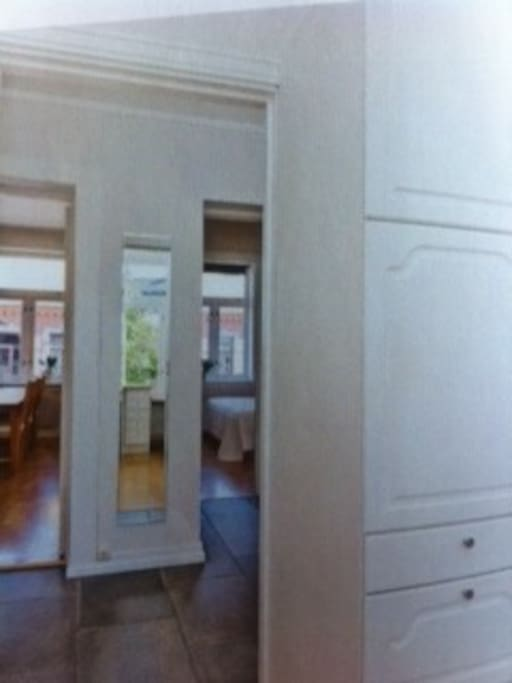 This picture is taken from the entrance to the kitchen. It shows the two separate bedrooms.