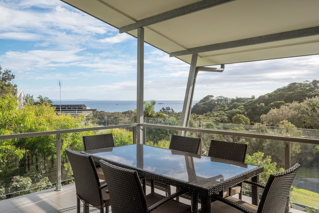 Undercover deck with ocean views and 200m to the beach