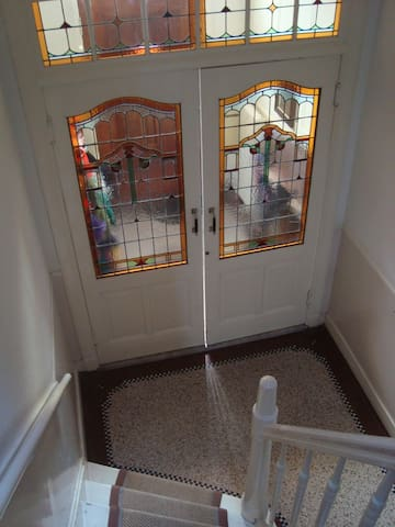 The main entrance of the house with lots of stained glass
