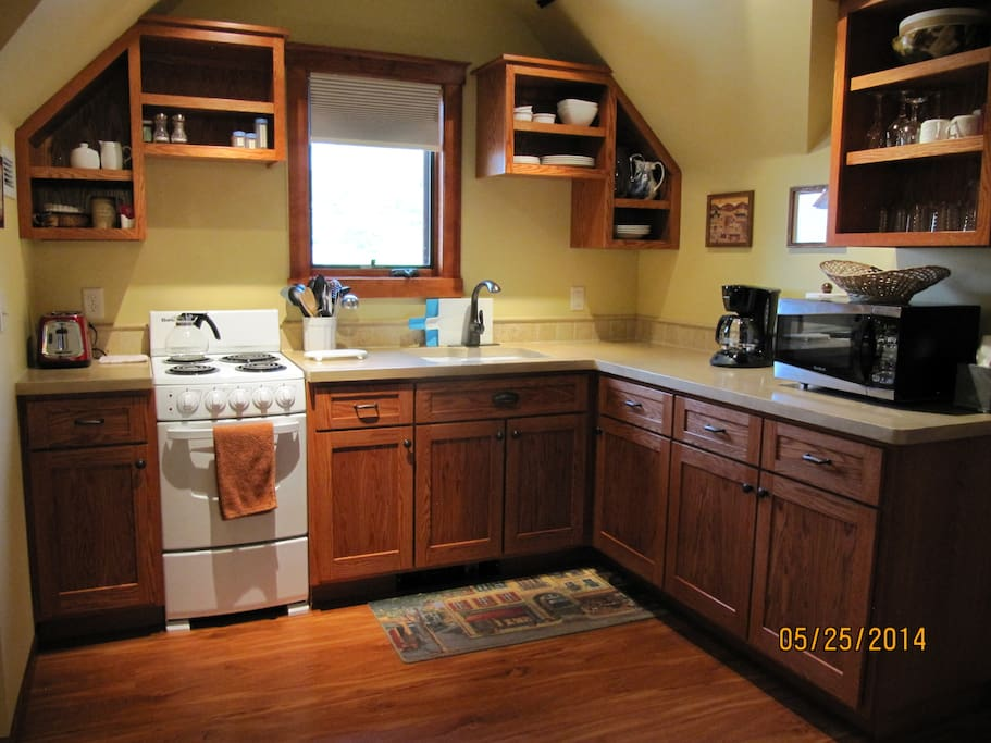 Spacious, well equipped kitchen.