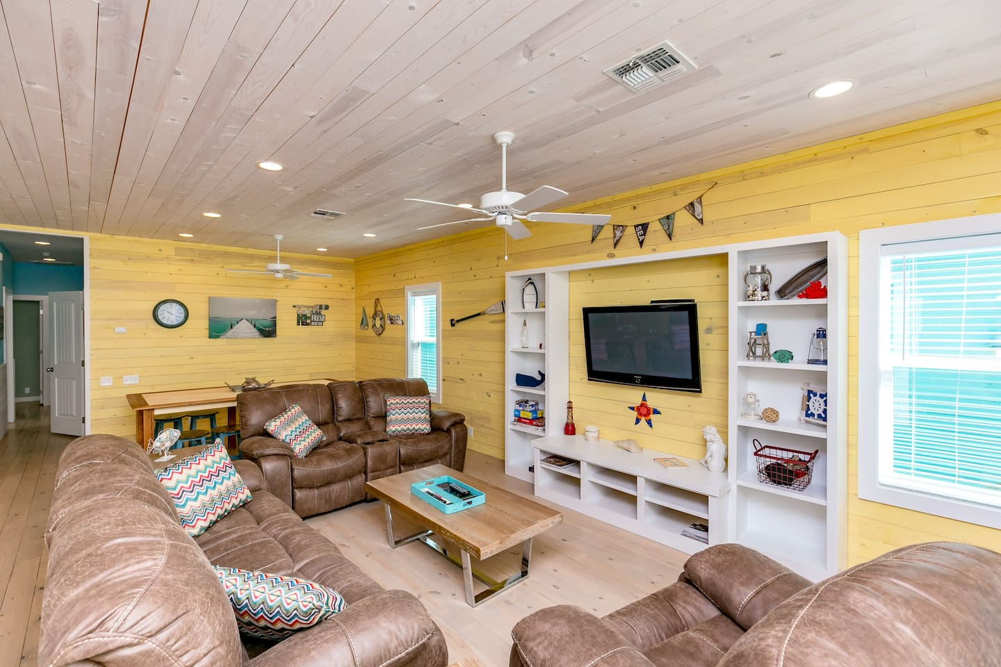 """One of the comfiest living areas in Port A! Sink into a plush couch for a movie on the 55"""" flatscreen."""