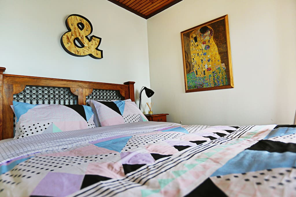Room #4 with balcony and queen bed