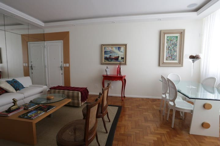 Spacious lounge area beautifully decorated with a dinning table
