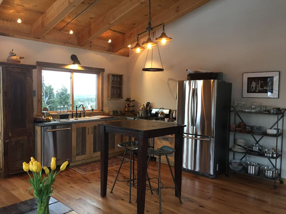 Stainless steel, galvanized metal counter tops and custom barn wood cabinets.