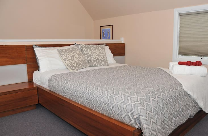 The Gardens Apartment Hobart - Queen-size bed, with inbuilt reading lights.