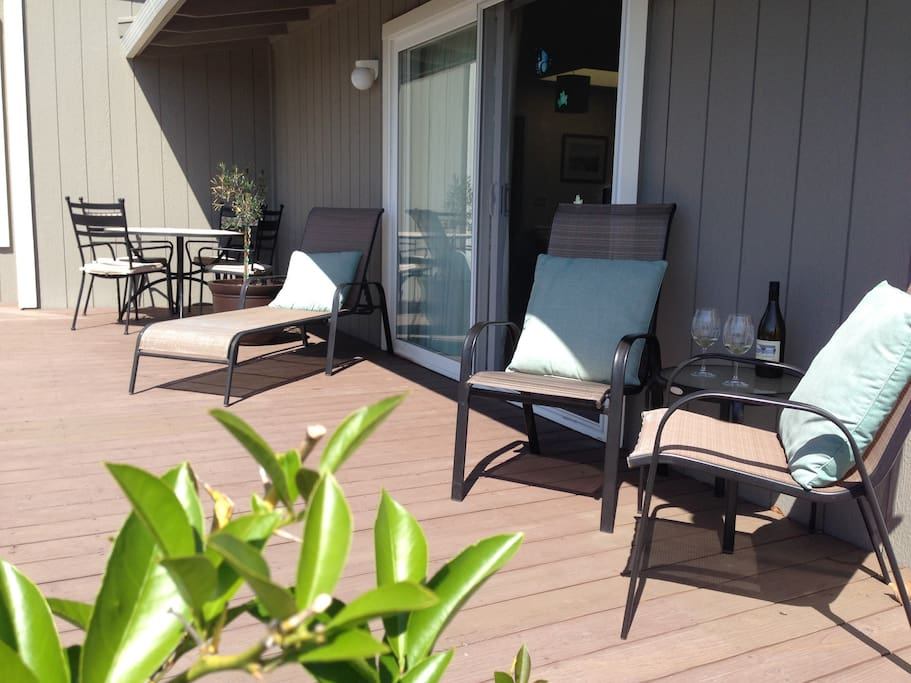 A large deck with a barbecue grill and stunning views of Annadel