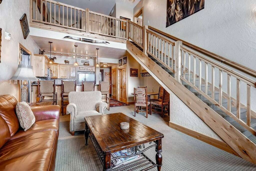 """Luxury and open concept Silverado condominium with vaulted ceilings, 55"""" HDTV, fireplace and mountain decor furnishings throughout."""