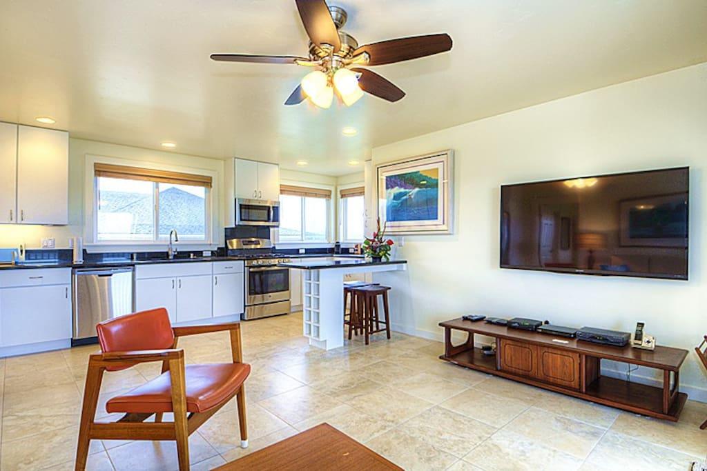 "Full sized kitchen,  Breakfast Nook, 60"" HDTV, High Quality Mid Century Modern Furnishings"