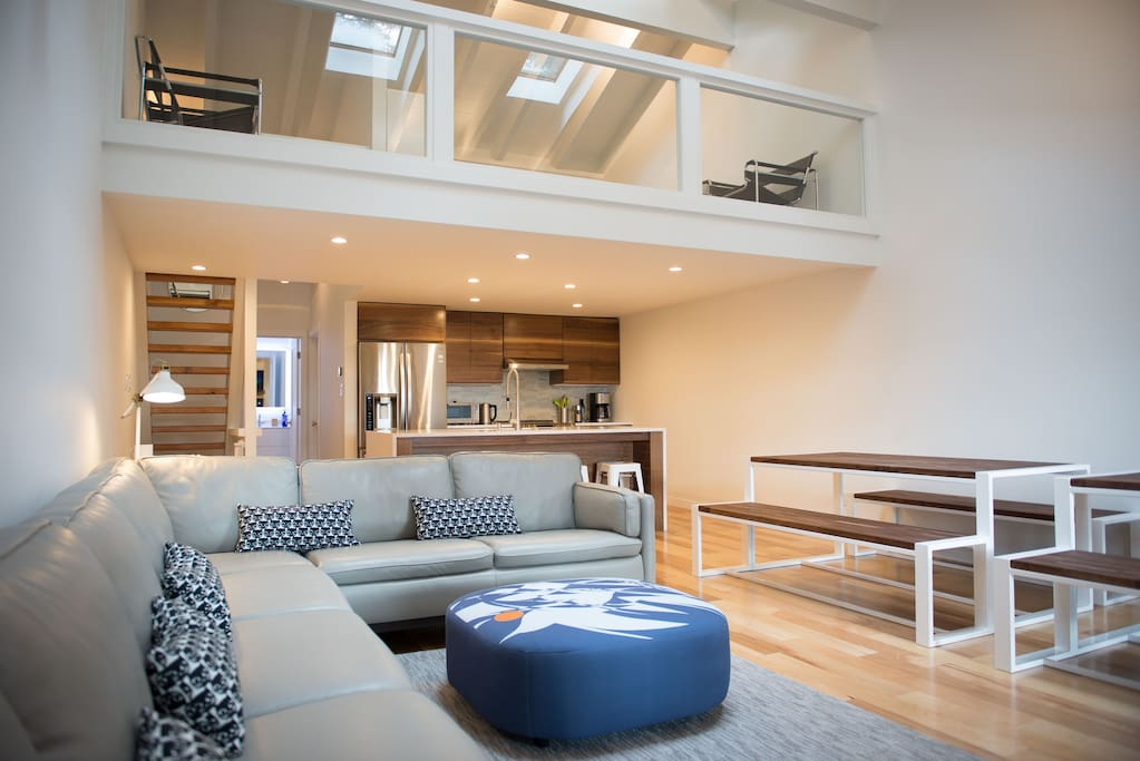 main living space with large loft above