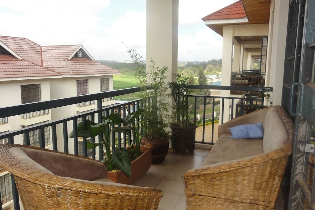 Large balcony with plants and comfortable sofa. Nice view on a small green valley especially at sunset!