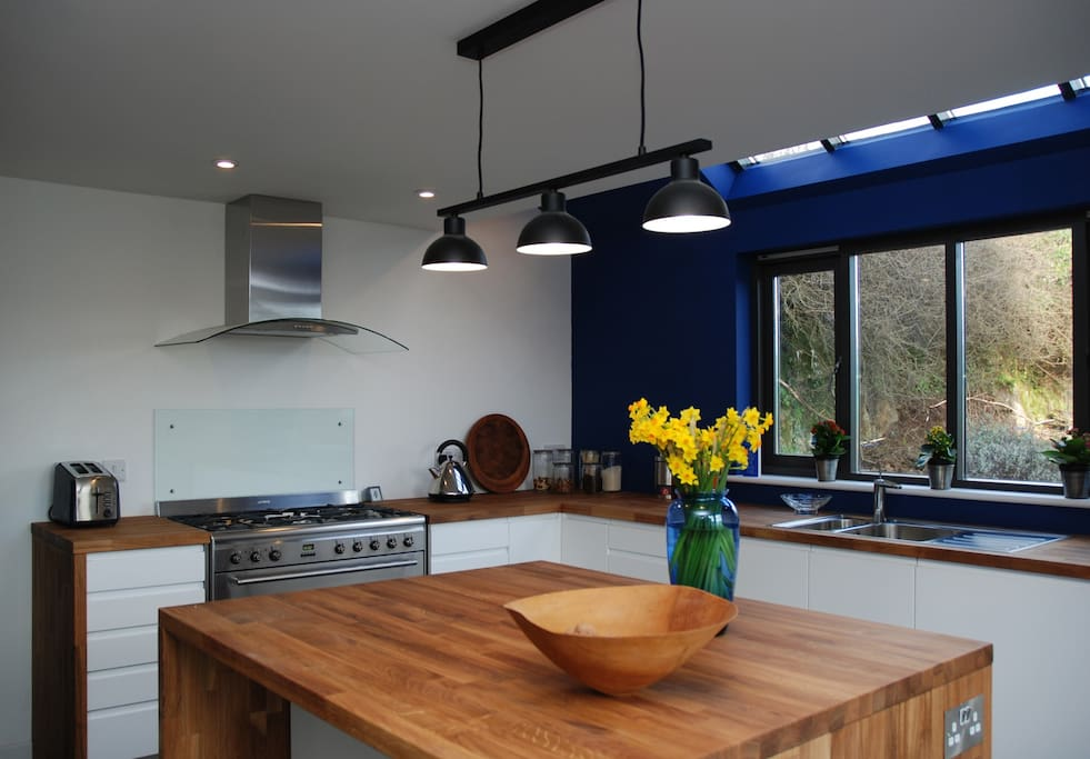 Modern Kitchen with smeg cooker and a large American style fridge freezer