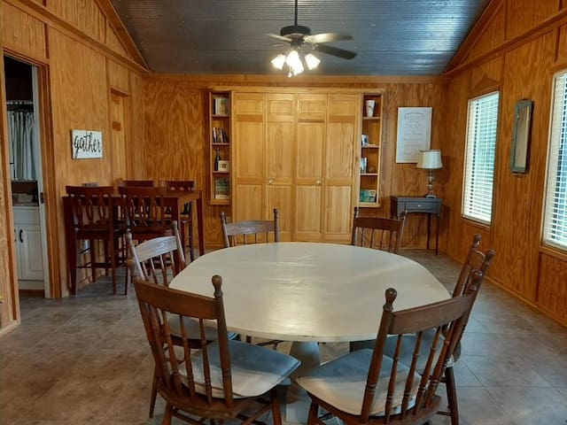 Dining area with seating for 14 including the breakfast bar.  Also, queen Murphy bed on the back wall.