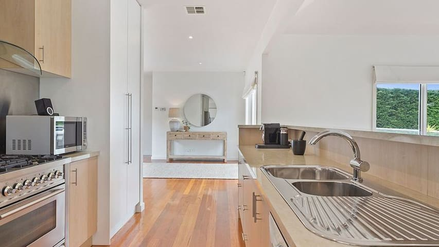 Open plan kitchen, central to all areas