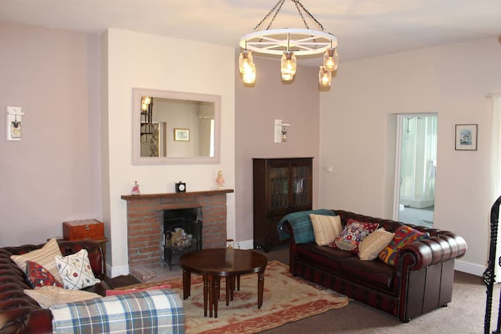 Cosy sitting room with open fire and sofa bed if required