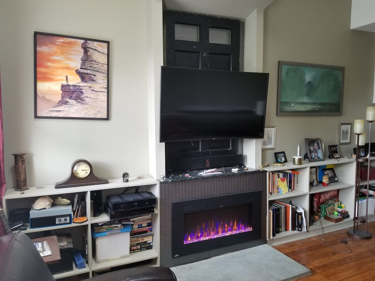 Mounted HD curved TV with Premium cable channels  and Electric Fireplace