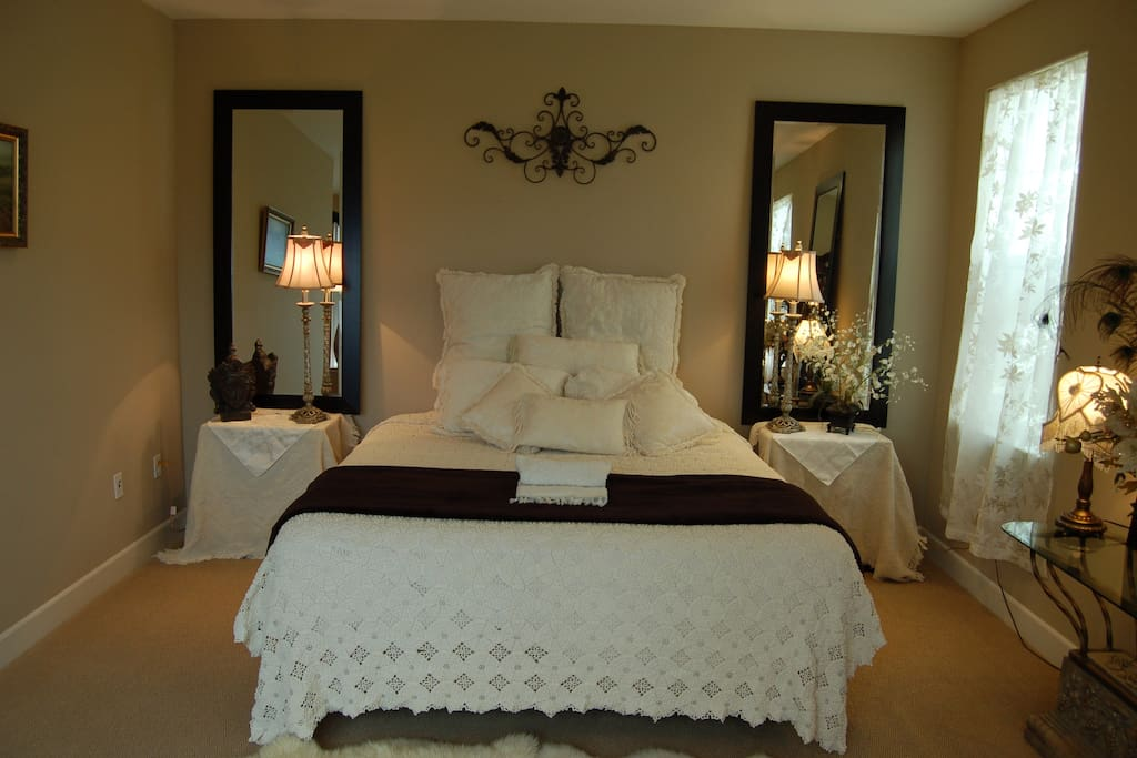 Georgous  large comfortable bedroom, private TV and spacious lounging  chair.