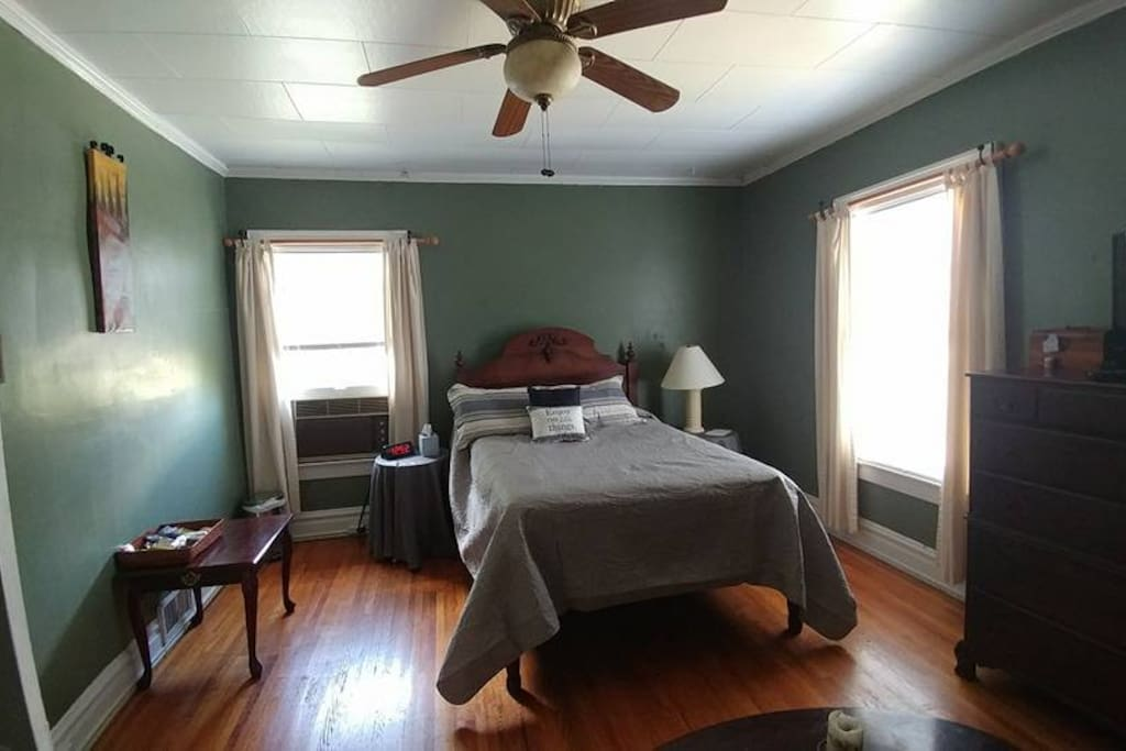 The Master Bedroom; original hardwoods, antique bed from my grandparent's farm; cherry wood accents