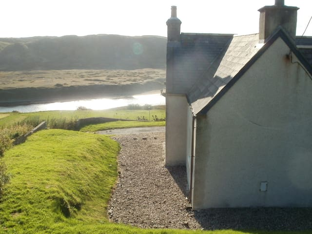 House looking over river from side