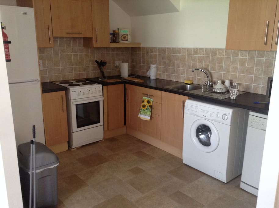 Kitchen with 4 spiral cooker large fridge freezer, washer and dishwasher.