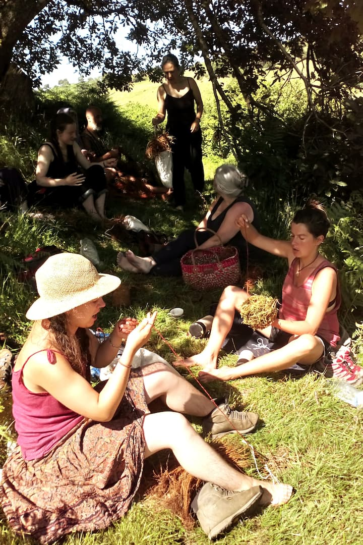 students weaving in the sun