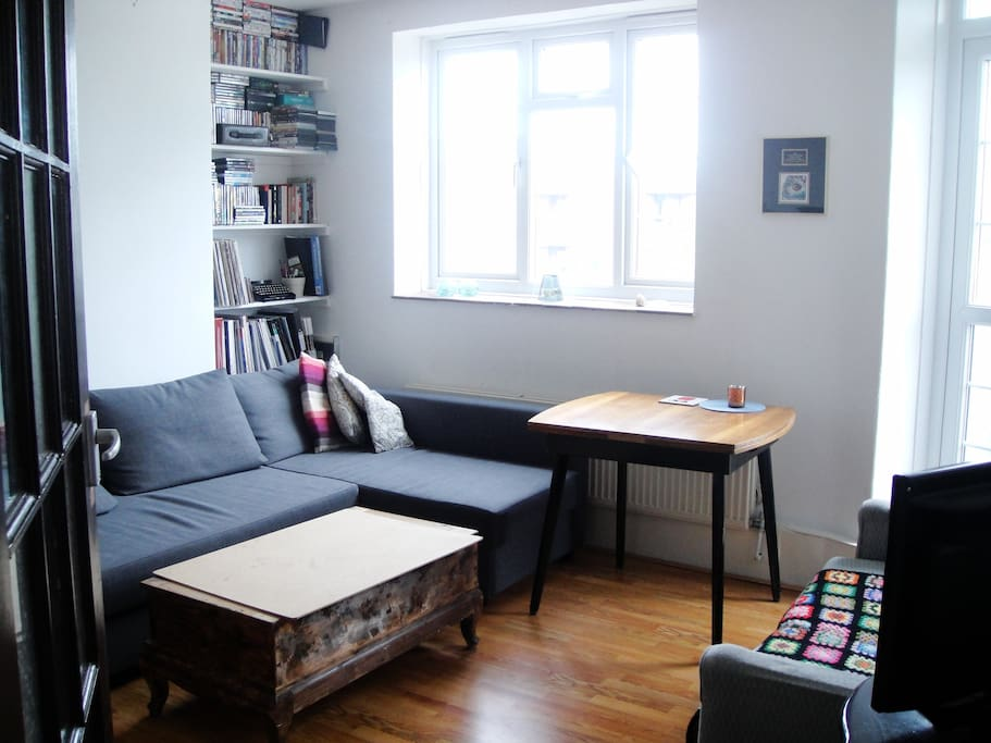 Spacious living room to share with three creative professionals. With TV, sofa bed and a solid selection of DVDs for a lazy night in!
