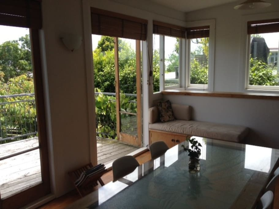 Dining Room with french doors opening to sun drenched deck