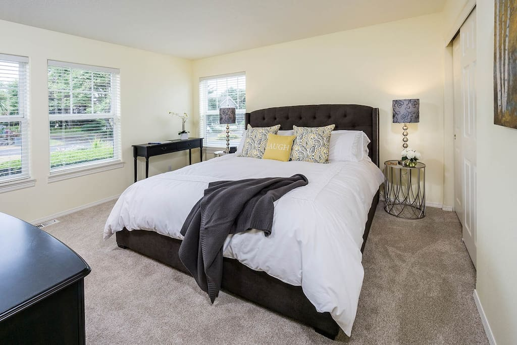 "Master bedroom suite with 37"" flat-screen TV - sleep peacefully in the king bed wrapped in a luxurious down comforter."