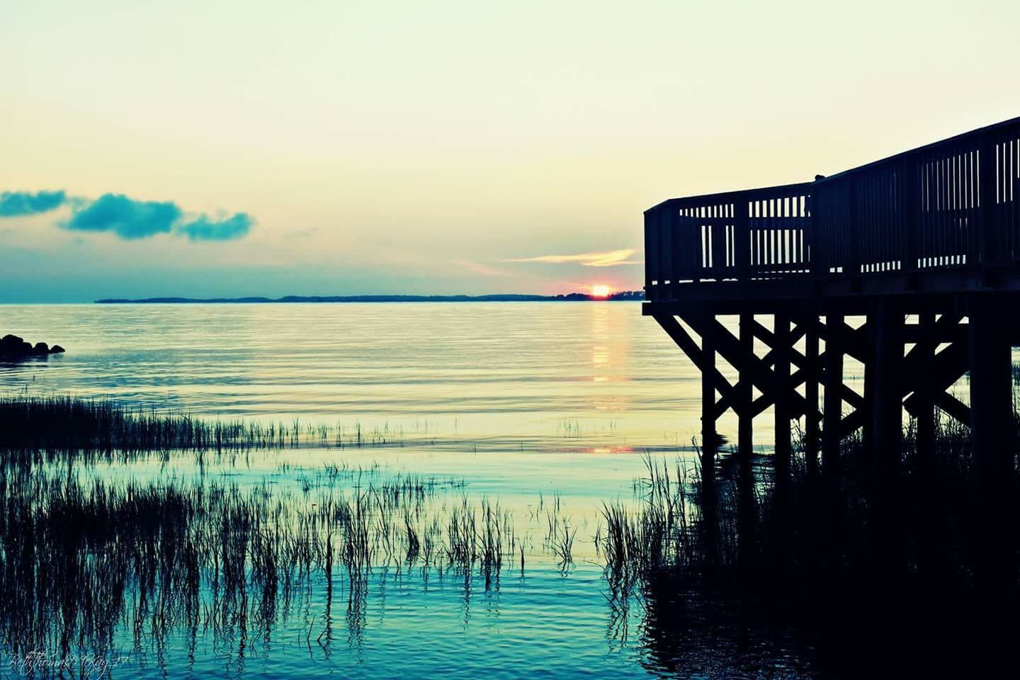 Our dock at sunrise and high tide. Many thanks to our neighbor Carol for catching this amazing sunrise picture!