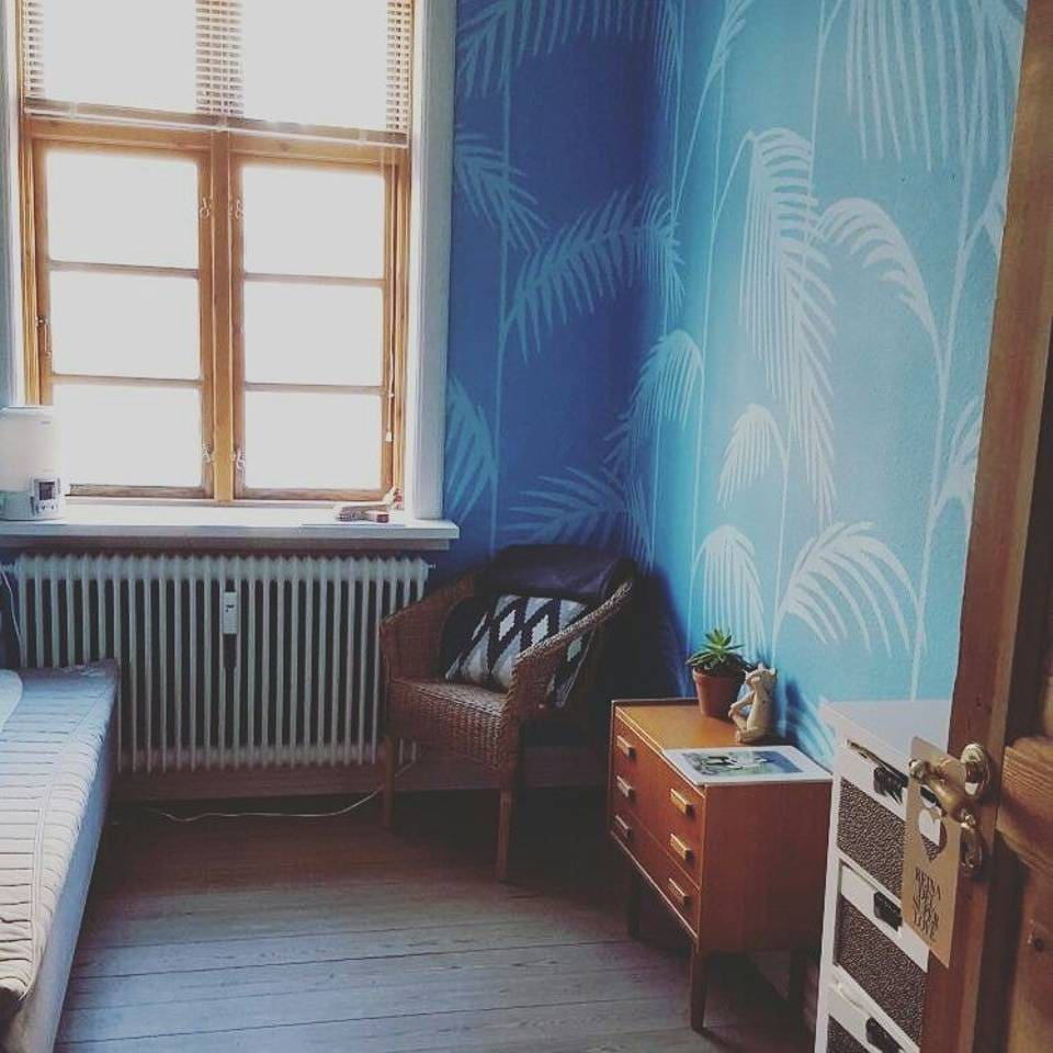 The room with handpainted wallpaper