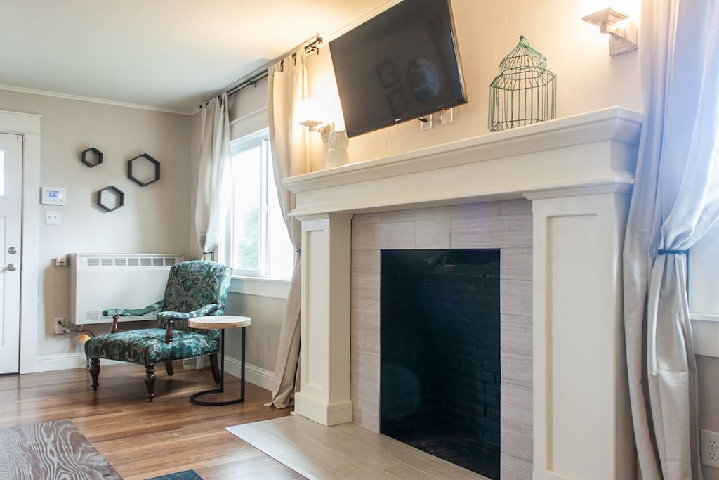 *Decorative* fireplace with flat screen cable TV