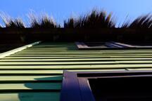 Flecks of straw roofing
