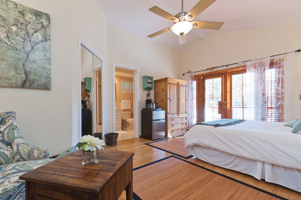 Vaulted ceilings, wood floors, French doors leading outside to a spacious yard