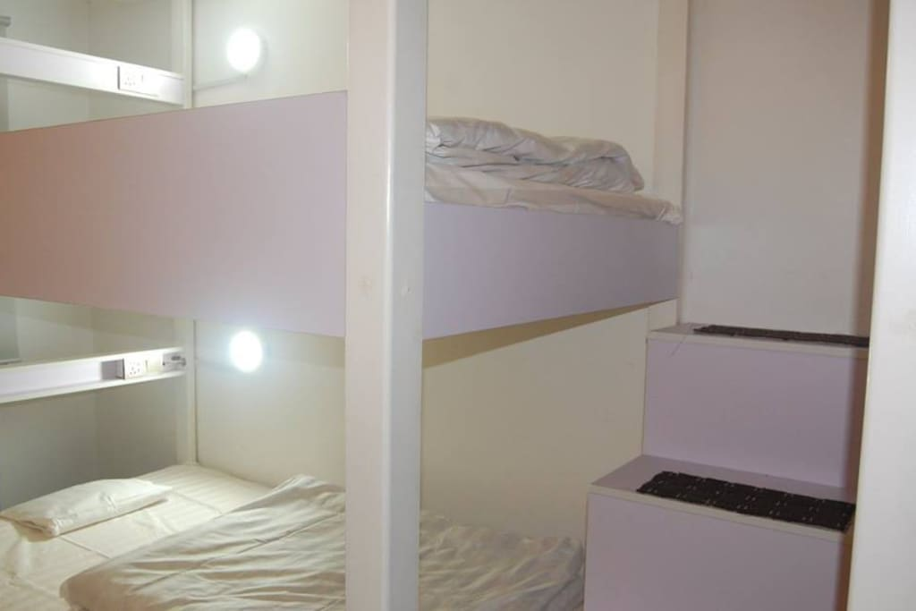 Each bunk has its own light and charger port.