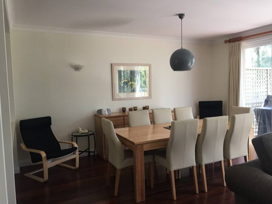 Modern dining suite with seating for up to 8 guests