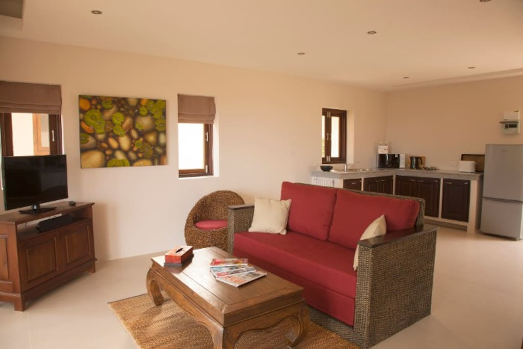 Lounge with TV and kitchen area