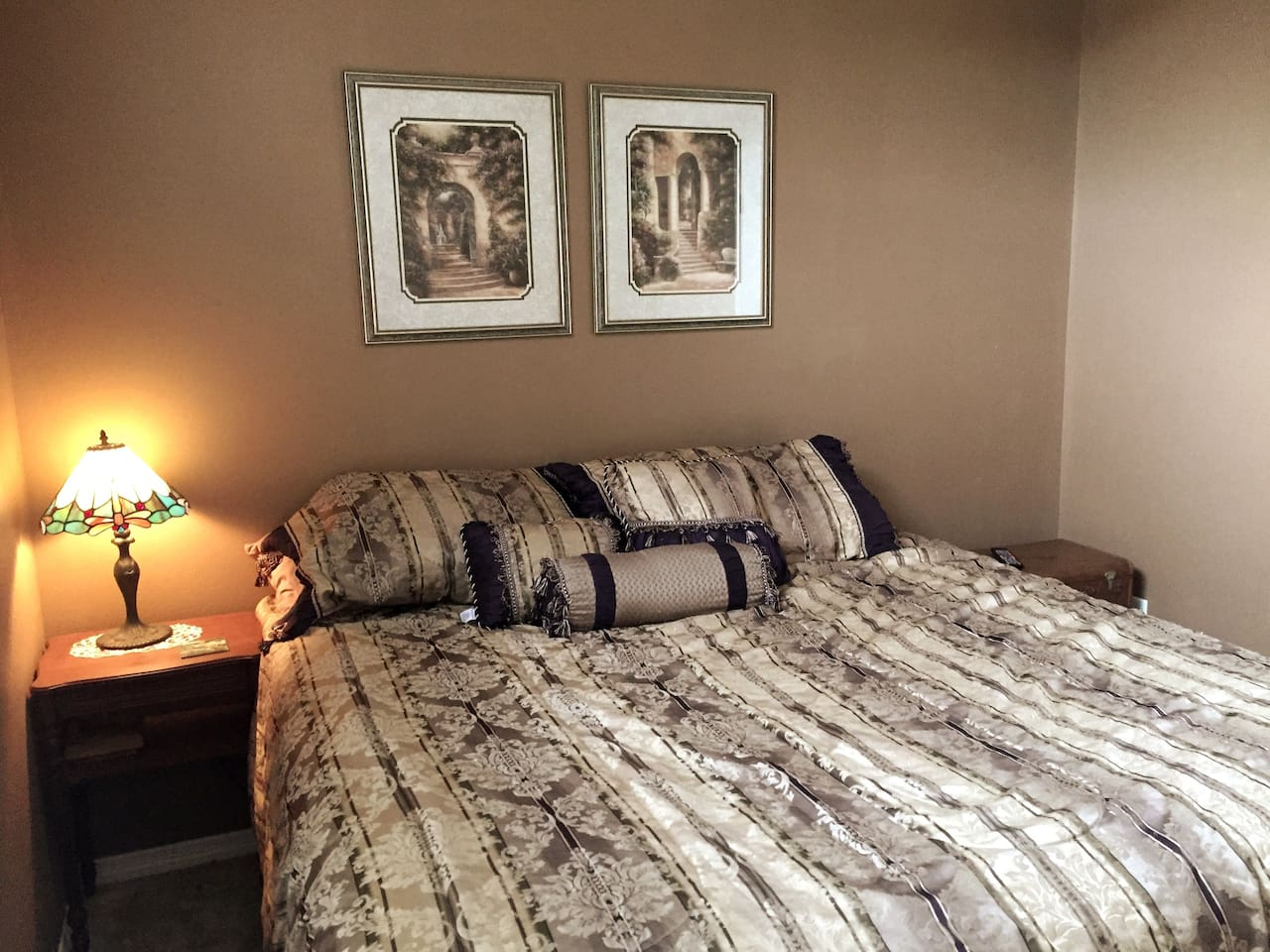 Your room with king-sized, pillow top bed.  The room has a 5-blade ceiling fan overhead, a large picture window, and room darkening curtains.