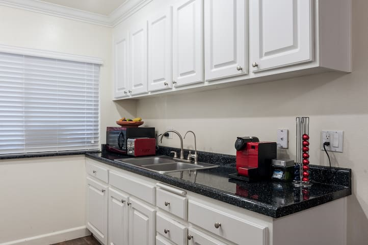 kitcken space with triple filtered H2O, microwave, and diningware available for guest if needed. guest room also has basic dishware, utensils and breakfast tray set up for  private dining use.