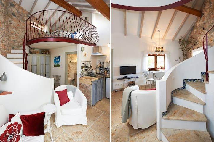 Full size stairs lead up to bedroom