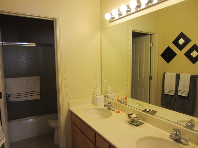 your own bathroom with 2 sinks, shower tub and essentials.