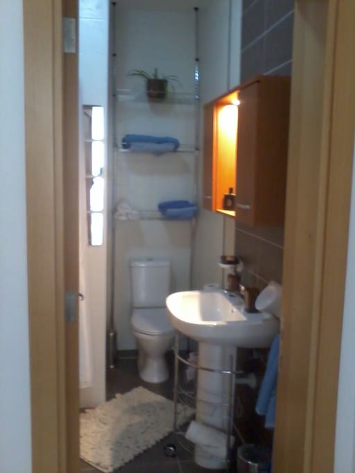 bath room with clean towels and other free amenities