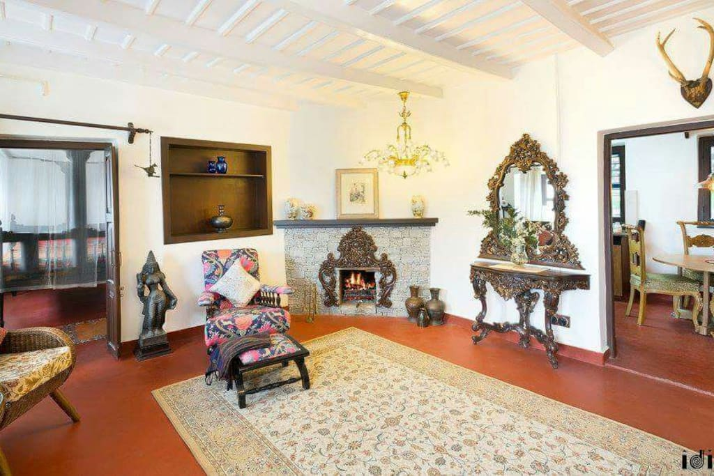 Living room with fire place console , good earth furniture coffee table and antiques.
