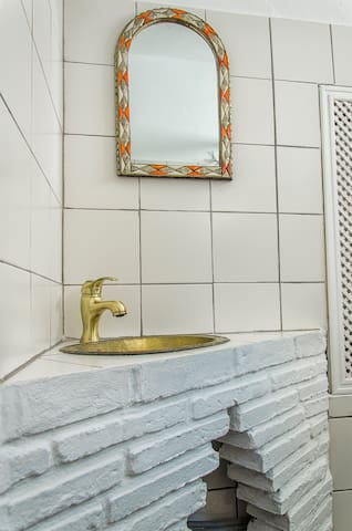 Bathroom sink and Moroccan mirror