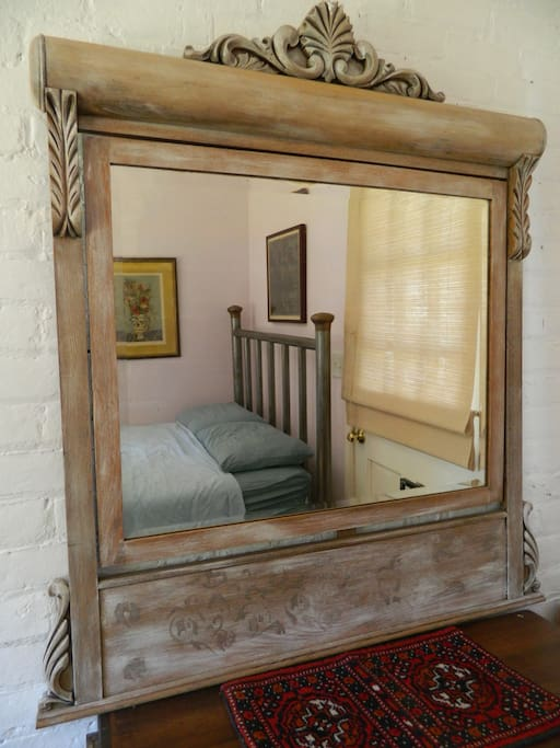 antique mirror in bedroom