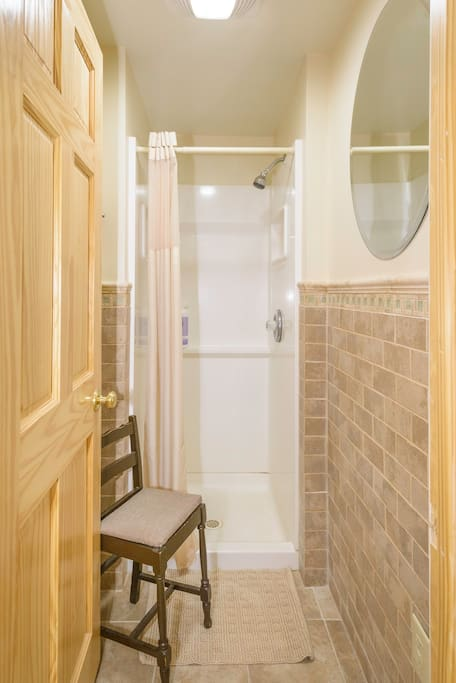 Separate, private, tiled shower stall.