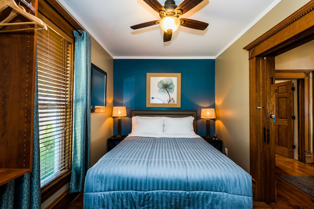 Room 1 with a luxury plush queen bed, private ensuite bathroom, swivel chair, wall-mount TV w/cable and WiFi. Heat and Central Air-conditioning.